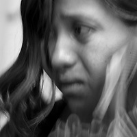 May 18, 2005 - Carmen Carazco, 27, cries as she files a report against her abusive husband at the Commission for Women and Children, in Managua, Nicaragua. Her husband punched her in the face the night before and has abused her for the past five years.