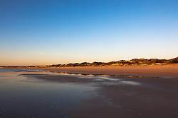 Late afternoon lights up Broome's famous Cable Beach on a low spring tide.