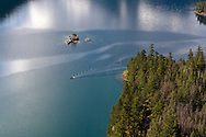 A small boat crossing Diablo Lake in North Cascades National Park, Washington State, USA.
