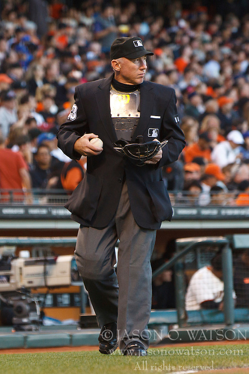 SAN FRANCISCO, CA - JUNE 26: MLB umpire Lance Barksdale #23 holds baseballs during the third inning between the San Francisco Giants and the Los Angeles Dodgers at AT&T Park on June 26, 2012 in San Francisco, California. The San Francisco Giants defeated the Los Angeles Dodgers 2-0. (Photo by Jason O. Watson/Getty Images) *** Local Caption *** Lance Barksdale