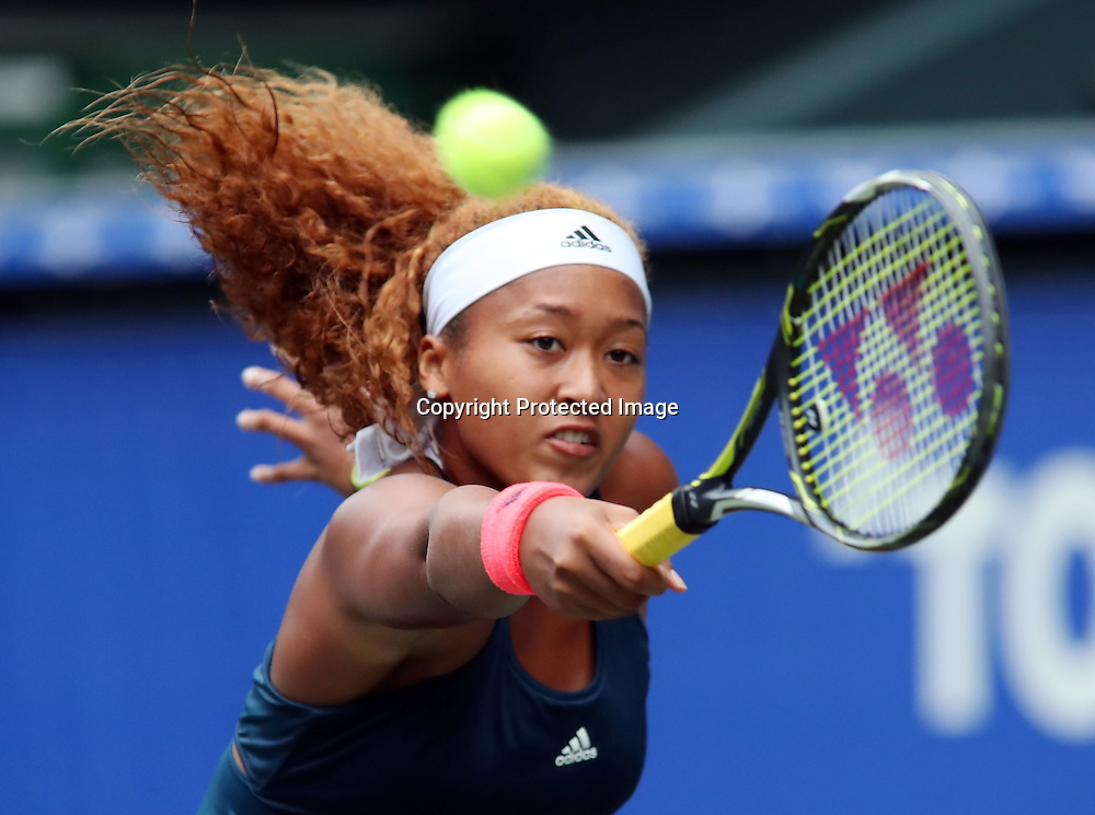 September 21, 2016, Tokyo, Japan - Naomi Osaka of Japan returns the ball against Slovakia's Dominika Cibulkova during the second round of the Toray Pan Pacific Open tennis championships in Tokyo on Wednesday, September 21, 2016. Osaka defeated Cibulkova 6-2, 6-1.   (Photo by Yoshio Tsunoda/AFLO) LWX -ytd-