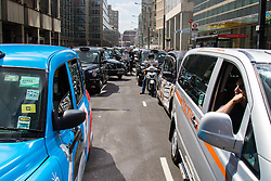 Victoria, London, May 26th 2015.  London's cabbies protest near Transport For London's HQ in Victoria against what they say is unfair competition from less regulated minicab operators who are supposed to take only pre-booked fares but are picking up passengers off the street, and the peer to peer Uber taxi-booking app which is making operating a licenced London taxi unsustainable. They complain that minicab operators fcould be putting the lives of their passengers at risk because they do not have to meet the same standards and background checks as black cab operators.