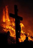 Wildfire burns near crucifix at  Catholic monastery in Sierra Madre.