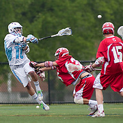 05/18/2011- Medford/Somerville, Mass. - Tufts midfielder Kevin McCormick (E12) gets an off-balance shot off a push from Cortland State midfielder Eric Parah in the Jumbos 10-9 win over Cortland State in the NCAA Tournament Quarterfinals at Bello Field on May 18, 2011. (Kelvin Ma/Tufts University)