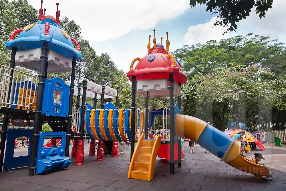 Kids playing in a park, Dist. 1, Ho Chi Minh city (HCMC), Vietnam, Asia