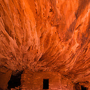 USA, Southwest, Utah, UT, Mule Canyon, Cedar Mesa, Ancient Native American granary wedged into a small niche deep in Mule Canyon on the Cedar Mesa, Utah.