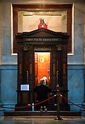 A woman inside confessional at basilica in Rome. (Sam Lucero photo)