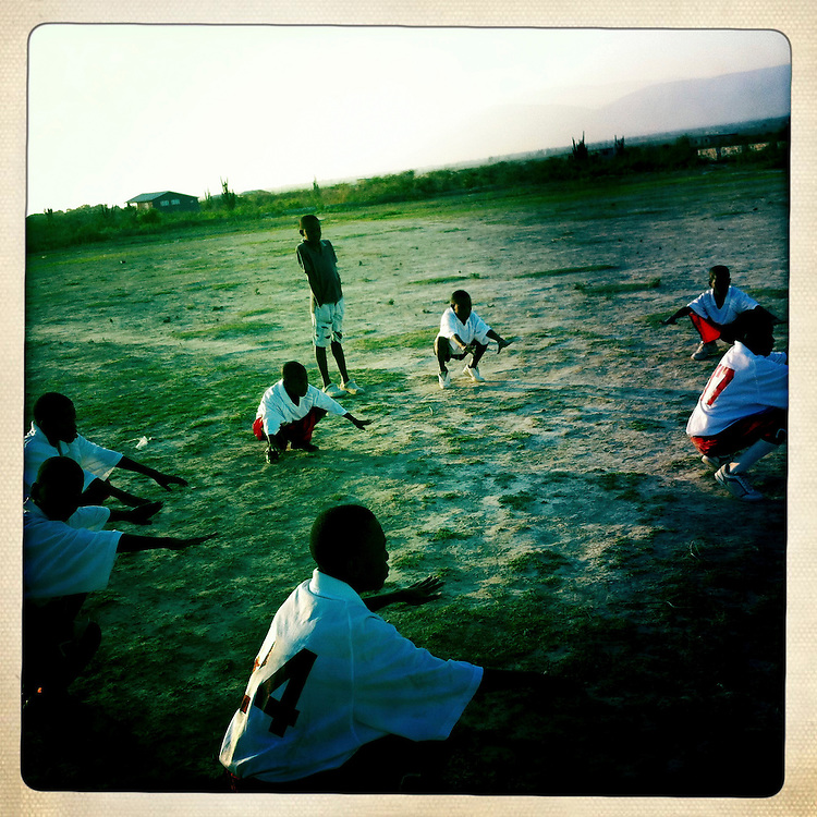 Boys warm up for soccer practice at the Corail camp on Friday, April 6, 2012 in Port-au-Prince, Haiti.