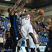 Delaware 87ers Guard Lorenzo Brown (17) drives towards the basket as Springfield Armor Guard Larry Anderson (2) defends in the course of a NBA D-league regular season basketball game between the Delaware 87ers (76ers) and the Springfield Armor (Nets) Saturday, Dec. 28, 2013 at The Bob Carpenter Sports Convocation Center, Newark, DE