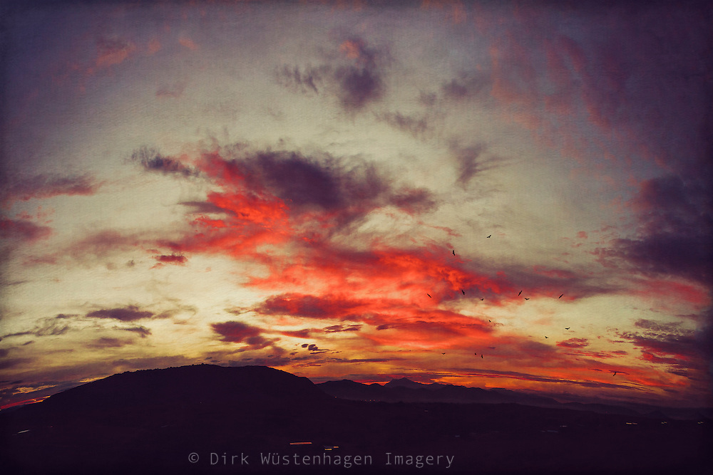 Sunrise in autumn in the valley of Oaxaca with the sacred Monte Albán in darkness.