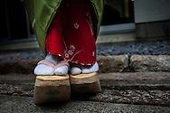 Okobo (tall wooden shoes).Detail of 'maiko' (geisha apprentice) from Ishihatsu tea house (o-chaia).Geisha's distric of Miyagawacho.Kyoto. Kansai, Japan.