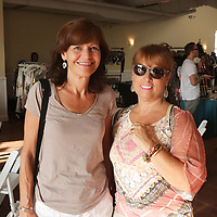 Laurie Buzzard, left, and Linda Meadows pose for a photo during Fashion On Front Thursday August 21, 2014 at Bakery 105 in Wilmington, N.C.(Jason A. Frizzelle)