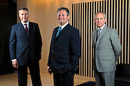 Brent Osborne (plain suit), David Morris (stripped suit) and Alan McLaren (grey suit), Joint Managing Directors of Landsbanki Commercial Finance, London, UK..