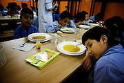 A boy rests his arm next to a soup plate during lunch at Uribarri public school. I visited Uribarri Public School in Bilbao to see how the children of new migrants to Bilbao were settling in with their Spanish classmates. Nowhere is a community's diversity reflected more strongly than in a school.