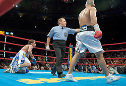 June 10, 2006 - New York, NY - WBO Champion Miguel Cotto (r) knocks down Paulie Malignaggi  during their 12 round Junior Welterweight Championship bout at Madison Square Garden.  Cotto retained his title via 12 round unanimous decision.