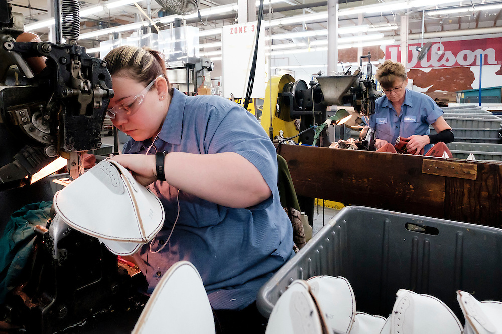 Katlin Long sews an official ball for the NFL Super Bowl 50 football game at the Wilson Sporting Goods Co. in Ada, Ohio, Tuesday, Jan. 26, 2016. The Denver Broncos will play the Carolina Panthers in the Super Bowl on Feb. 7 in Santa Clara, CA. (AP Photo/Rick Osentoski)