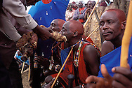 New Kenyan Masia elders (right) are fed the meat of a freshly slaughtered cow to celebrate their elevation to elder, during their participation in the three day festival of Masia warriors in Kajiado, Kenya on Saturday, November 10, 2001. The traditional Masai Manyatta festival brings Kenyan men and women together to celebrate the younger Masai warriors reaching the next age level to become junior elders.