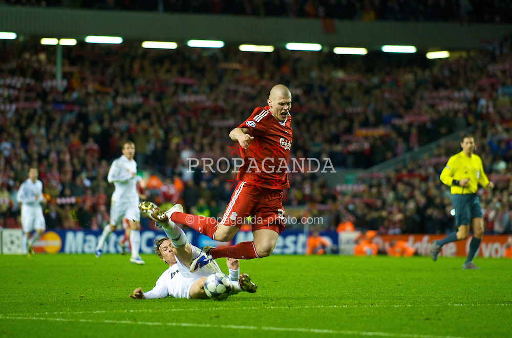 LIVERPOOL, ENGLAND - Tuesday, March 10, 2009: Liverpool's Martin Skrtel is fouled by Real Madrid's Jose Maria Gutierrez Herna?ndez 'Guti' during the UEFA Champions League First Knockout Round 2nd Leg match at Anfield. (Photo by David Rawcliffe/Propaganda)