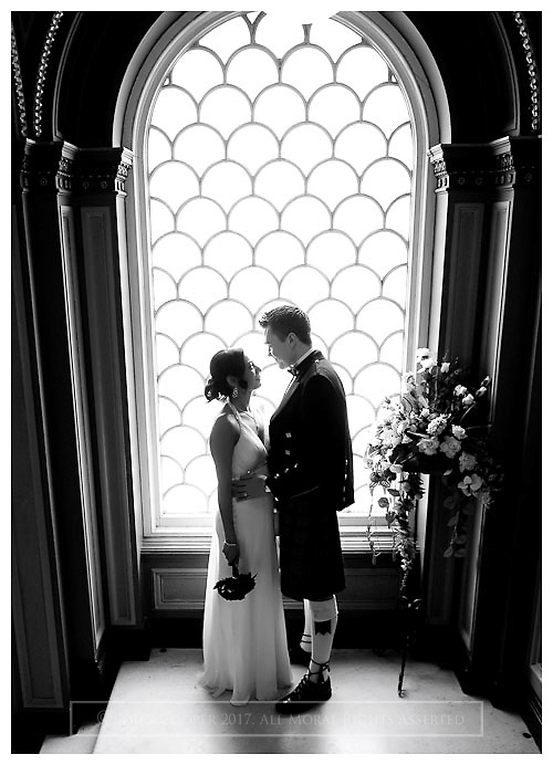 Bride and Groom at their wedding in Park Circus, Glasgow.