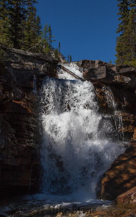 Waterfalls along a path above Shadow Lake and below Mount Ball in Banff National Park, Alberta.