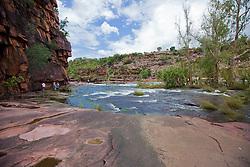 Tourists visit Camp Creek in the Kimberley wet season