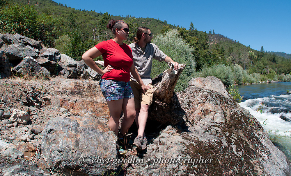 Natasha and Andy on the banks of the Rogue River in Gold Hill, OR on Sunday, July 24, 2016.  © Chet Gordon • Photographer  #oregon #OR #goldhill #rogueriver #gold #photojournalism #travel