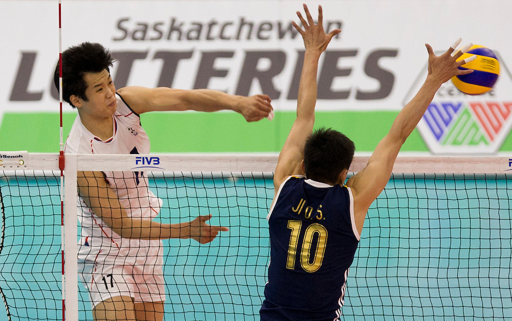 Jae-Duck Seo (17) of Korea spikes the ball on Daoshuai Ji (10) of China at a World League Volleyball match at the Sasktel Centre in Saskatoon, Saskatchewan Canada on June 26, 2016.