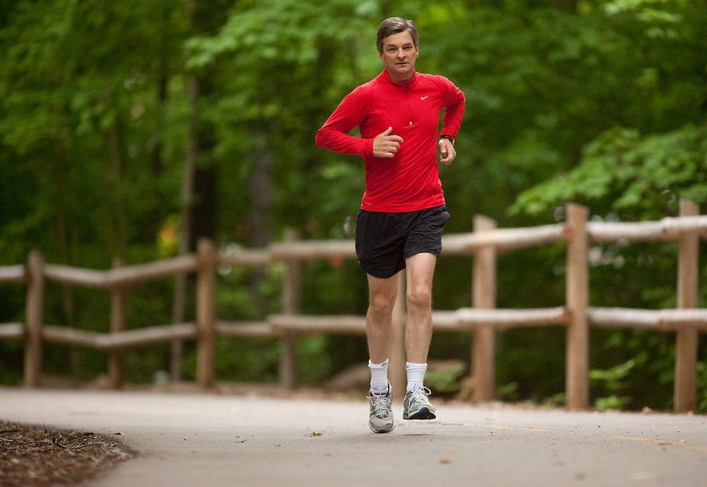 London, Ontario ---11-06-11---  London West MPP and Ontario Attorney General Chris Bentley runs through Springbank Park  in London, Ontario June 11, 2011.<br /> GEOFF ROBINS/Mundo Sport Images