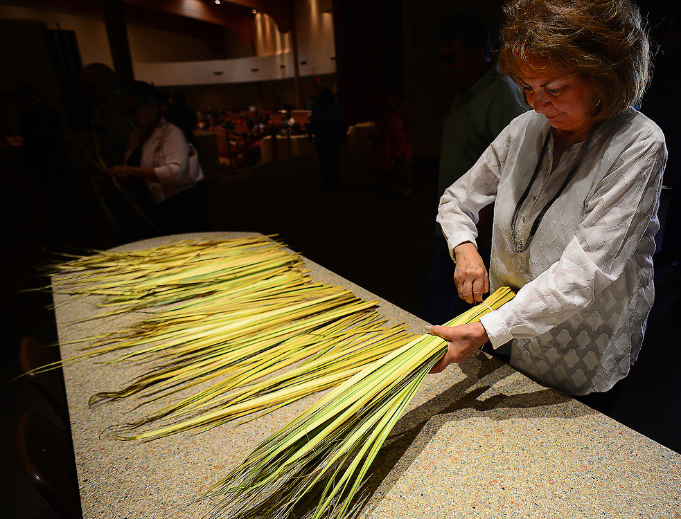 apl040917e/ASECTION/pierre-louis/JOURNAL 040917<br /> Altar Society Member Jean  Benavidez,,unpacks palms  before the 12:15 pm Mass at Our Lady of the Most Holy Rosary Catholic Church on Albuquerque West Mesa. Palm Sunday marks the beginning of Holy Week for Christians. Photographed on Sunday April 9, 2017. .Adolphe Pierre-Louis/JOURNAL