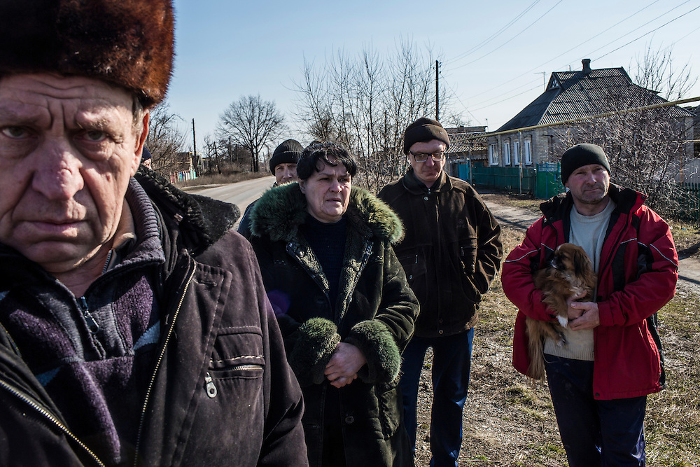 MARIINKA, UKRAINE - FEBRUARY 20, 2016:  Local residents wait for volunteers from the Christian Help Center of the Church of the Transfiguration to distribute free bread, as well as Christian literature, in Mariinka, Ukraine. The Donetsk suburb has been the scene of some of the heaviest fighting recently between Ukrainian forces and pro-Russian rebels. CREDIT: Brendan Hoffman for The New York Times