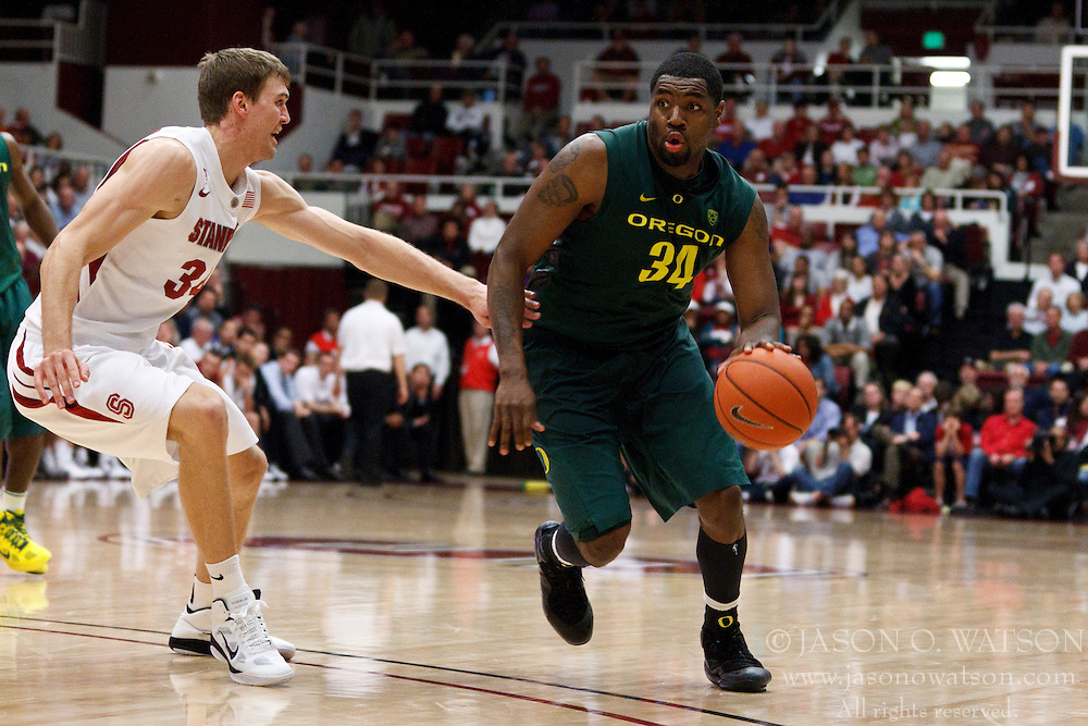 January 27, 2011; Stanford, CA, USA;  Oregon Ducks forward Joevan Catron (34) is defended by Stanford Cardinal forward Andrew Zimmermann (34) during the second half at Maples Pavilion.  Oregon defeated Stanford 67-59.