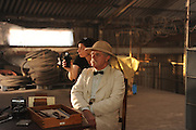 "Produktion ""Schweitzer"".Photo © Stefan Falke / NFP..from left to right:.Schweitzer (Jeroen Krabbe).DOP: Cinders Forshaw..44 DAY 11.INT.PORT GENTIL DOCKS - WAREHOUSE.Marcel offers Schweitzer a drink."