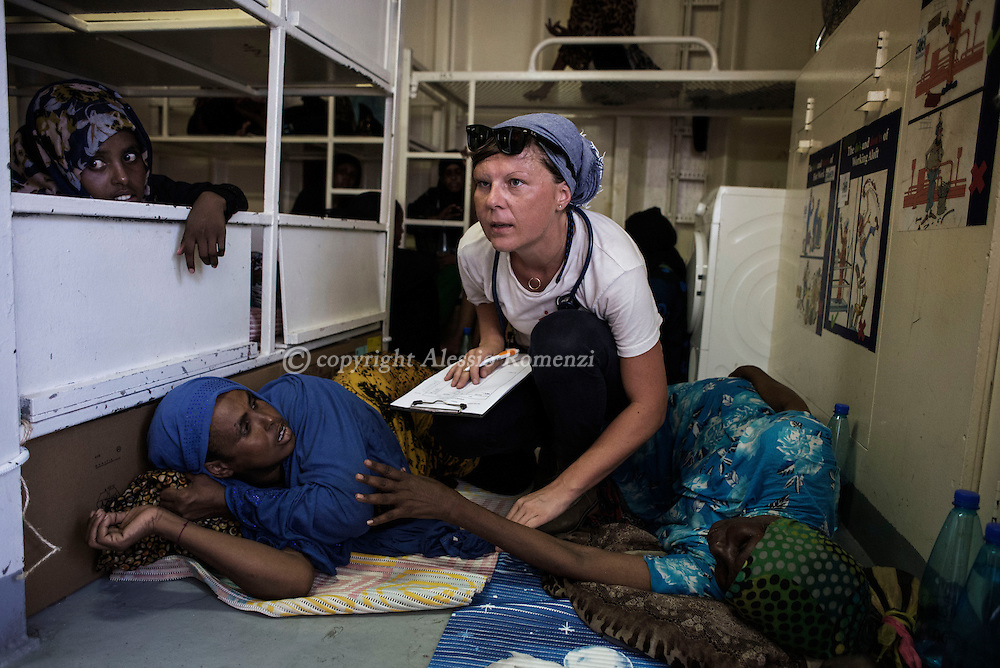 Italy: MSF Dignity1: Doctor Barbara Sollerova examines African women rescued at the sea and transferred on the Dignity1 on August 23, 2015. Alessio Romenzi