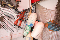 restaurant display of buoys, lobster and nets