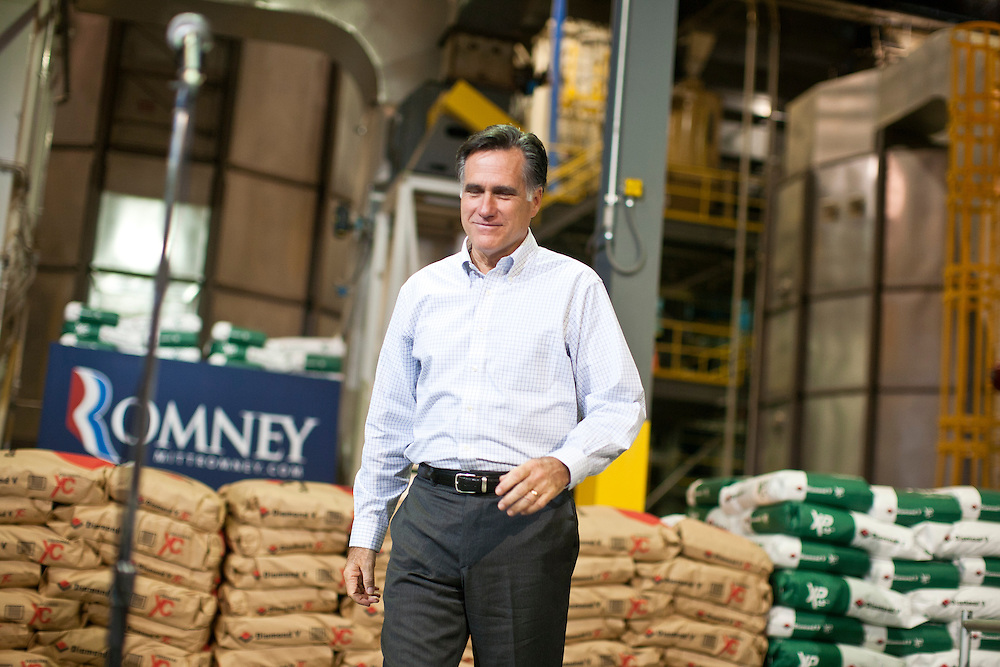 Republican presidential candidate Mitt Romney walks to the microphone for a media availability after a town hall meeting at the Diamond V South Plant on Friday, December 9, 2011 in Cedar Rapids, IA.