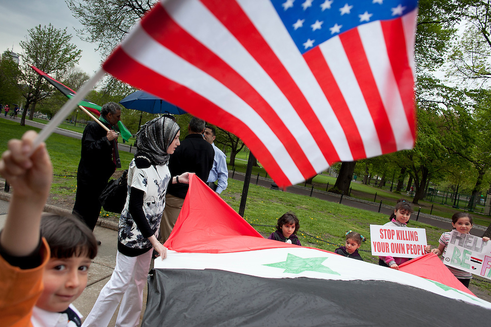 People gather on Boston Common for a rally to raise awareness for the situations in Syria and Libya yesterday.