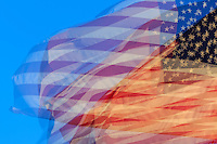 Impression of an American flag blowing in the wind.