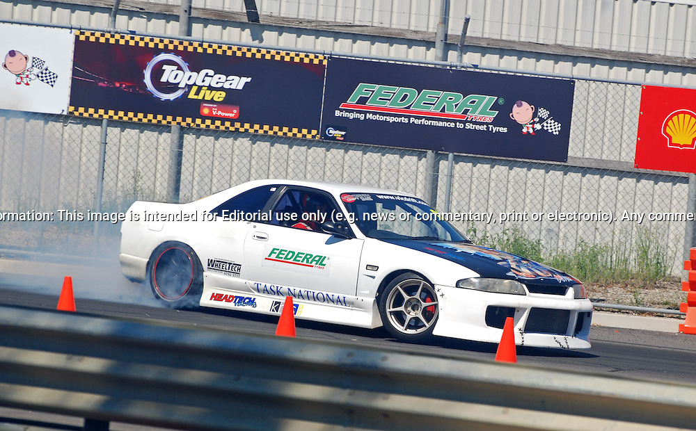 Topgear Live Festival - Outdoor Racetrack .The Melbourne Showgrounds .Flemington. Melbourne, Victoria.13th March 2011.At the heart of the Festival will be a 1.52km, purpose-built track which will weave through the streets and buildings of the showground precinct..The Top Gear Live track, the first ever to be constructed in Australia, will play host to over 120 of the country's best drivers as they take part in a spirited competition to set the fastest Top Gear Live lap..With over 20 corners, ranging from the tight and technical 'Woodchop' and 'Town Square', to the fast and furious 'Power Arena', spectators will have unprecedented access plus the opportunity to get up close with drivers and cars, as well as checking out all the action. Cars likely to be on the track range from the likes of V8 Supercars, multiple Bathurst's 12hr class winners, prototype race cars, historic and modern tarmac rally cars, V8 muscle cars and historic open wheel racing cars..(C) Joel Strickland Photographics.Use information: This image is intended for Editorial use only (e.g. news or commentary, print or electronic). Any commercial or promotional use requires additional clearance.