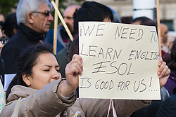 London, October 14th 2015. Immigrants and teachers of English for speakers of other languages protest at Parliament Square ahead of lobbying MPs over cuts that mean very low paid workers and assylum seekers cannot afford English lessons and other adult education opportunities, further hampering their integration into their communities. At the same time ESOL teachers are facing job cuts.