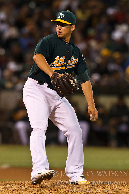 OAKLAND, CA - JUNE 20: Tommy Milone #57 of the Oakland Athletics pitches against the Los Angeles Dodgers during the eighth inning of an interleague game at O.co Coliseum on June 20, 2012 in Oakland, California. The Oakland Athletics defeated the Los Angeles Dodgers 4-1. (Photo by Jason O. Watson/Getty Images) *** Local Caption *** Tommy Milone