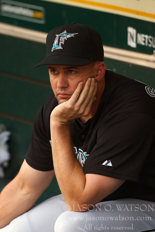 June 28, 2011; Oakland, CA, USA;  Florida Marlins first baseman Gaby Sanchez (15) sits in the dugout during a rain delay before the game against the Oakland Athletics at the O.co Coliseum.