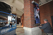 Jay Leonardo (right) and Jeremy Dana of Design & Display install banners of Ole Miss All-American baseball players at Oxford-University Stadium in Oxford, Miss. on Monday, February 11, 2013. 17 banners are being erected and signage in the stadium is being updated.