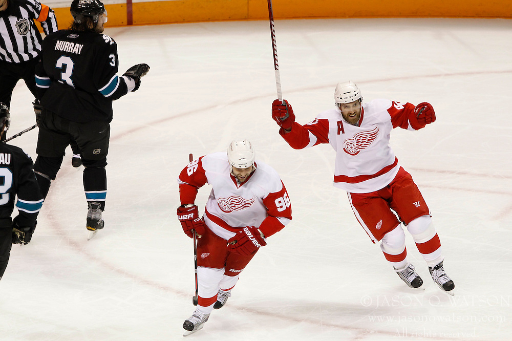 April 29, 2011; San Jose, CA, USA; Detroit Red Wings left wing Tomas Holmstrom (96) and center Henrik Zetterberg (right) celebrate after defenseman Nicklas Lidstrom (not pictured) scored a goal against the San Jose Sharks during the first period of game 1 of the western conference semifinals of the 2011 Stanley Cup playoffs at HP Pavilion. Mandatory Credit: Jason O. Watson / US PRESSWIRE