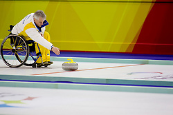 PINEROLO, ITALY - MARCH 15th : Team Sweden skipper Jalle Jungnell releases the stone during the last round-robin match of the curling competition between Sweden and Denmark during Day 5 of the Turin 2006 Winter Paralympic Games on March 15th, 2006 at the Pinerolo Palaghiaccio Stadium in Turin, Italy.