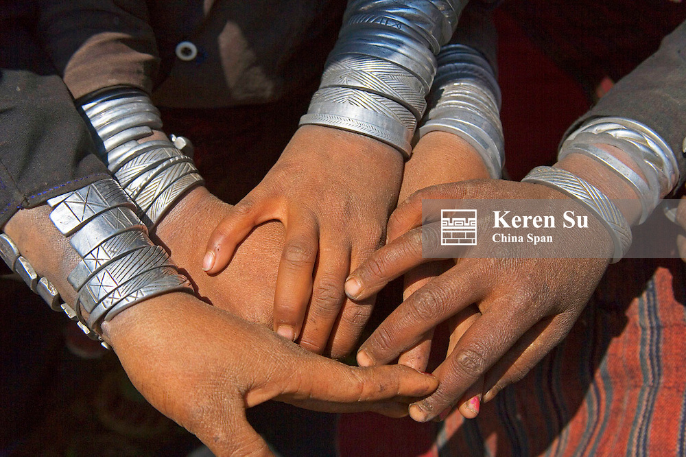 Akha people, arms decorated with silver bracelets, Kengtung, Myanmar