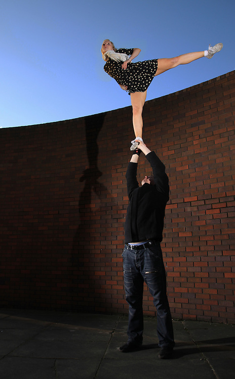 Cheerleading single based partner stunt arabesque