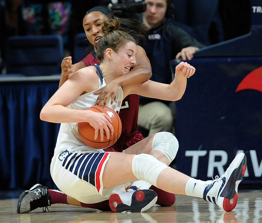 Connecticut's Katie Lou Samuelson, front, and Temple's Feyonda Fitzgerald, back, flight for possession of the ball in the first half of an NCAA college basketball game, Saturday, Jan. 16, 2016, in Storrs, Conn. (AP Photo/Jessica Hill)