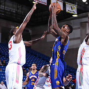 Santa Cruz Warriors Guard Sean Kilpatrick (9) drives towards the basket as Delaware 87ers Forward Victor Rudd (23) defends in the second half of a NBA D-league regular season basketball game between the Delaware 87ers and the Santa Cruz Warriors (Golden State Warriors) Tuesday, Jan. 13, 2015 at The Bob Carpenter Sports Convocation Center in Newark, DEL