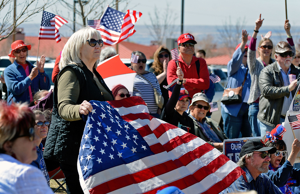 jt030417e/a sec/jim thompson/Betsy Cherry waves a flag  during the Trump Rally at the North Domingo Baca Park Saturday afternoon. Saturday March 04, 2017. (Jim Thompson/Albuquerque Journal)
