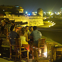 Local and tourists can enjoy the ocean breeze while zipping a drink at Cafe del Mar in Cartagena.